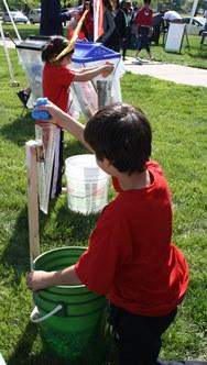 Kids race to fill the rain gauge