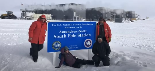 """Kelly Brunt and others pose with the """"Amundsen-Seott South Pole Station"""""""