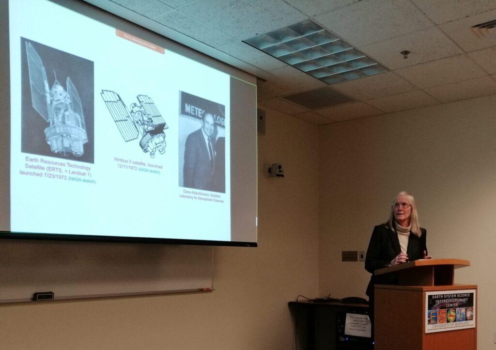 A seminar speaker presents at the ESSIC-branded podium
