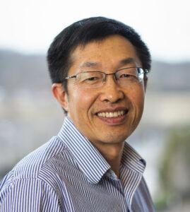 Dr. Liang smiles at the camera