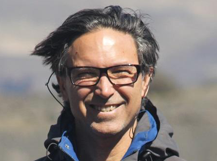 Santiago Gasso smiles brightly in a dusty landscape