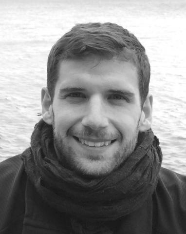 Alejandro Egido smiles warmly in front of the ocean