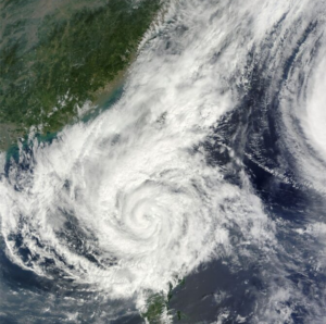 A satellite image of a tropical storm raging along an undefined shoreline
