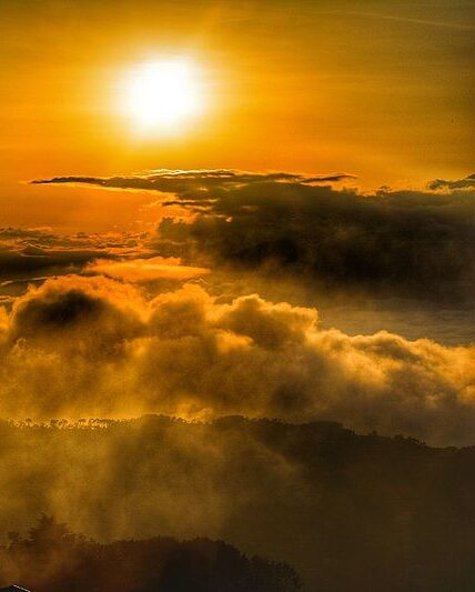 A cloud of dust obscures a beautiful orange sunset