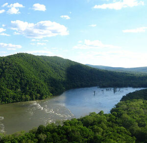 The Potomac River winds through dense green forests
