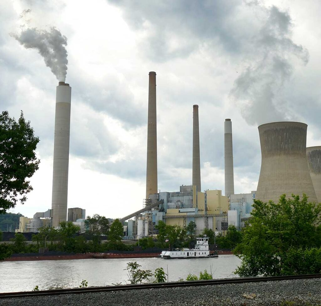 The concrete plumes of a power plant emit steam into the atmosphere