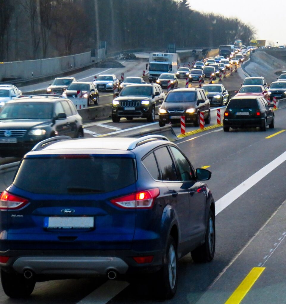 Many cars on a highway are stuck in a traffic jam