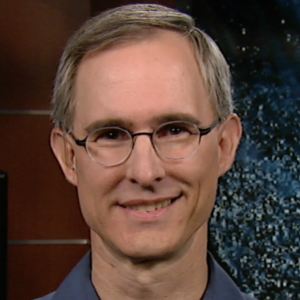 The headshot of Dr. Scott Braun, smiling at the camera wearing glasses and a blue polo