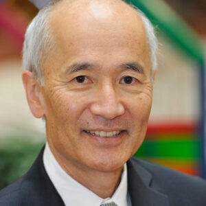 The portrait photo of Roger Wakimoto